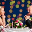 Bride and groom at cafe — Stock Photo #5754771