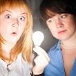 Women with bulb — Stock Photo
