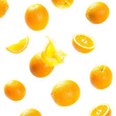 Falling and exploding ripe oranges — Stock Photo