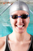 Smiling woman swimmer — Stock Photo