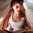 Writing under cover — Stock Photo