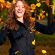 Throwing leaves in park — Stock Photo #6088086