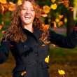 Throwing leaves in park — Stock Photo