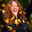 Throwing leaves in park — Stock Photo #6088107