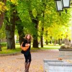 Walking at autumn city park — Stock Photo