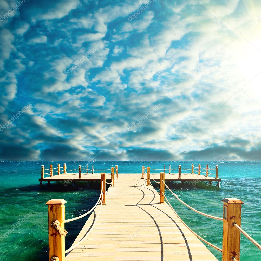 Tropical wooden pier in turquoise sea at sunny weather, clear skies — Stock Photo #6088099