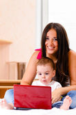 Mother and son are using laptop — Stockfoto