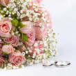 Bouquet  roses and weddings rings - Stock Photo