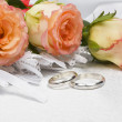 Stock Photo: Beautiful rose and wedding rings
