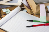 Opened notebook, old books, pens — Stock Photo