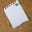 Corkboard with a sheet from a notebook - Stock Photo