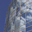 Skyscraper with reflections of clouds — Stock Photo