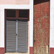 Wooden broun painted and metal doors — Stock Photo