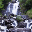 Milky waterfall near Ritsa lake — Stock Photo