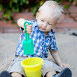 Toddler playing in sandbox — Stock Photo