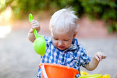 Toddler playing in sand — Stock Photo