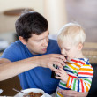 Father and son having a breakfast — Stock Photo