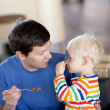 Father and son having a breakfast — Stock Photo #6140480