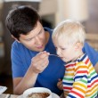 Father and son having a breakfast — Stock Photo #6140489