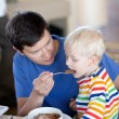 Father and son having a breakfast — Stock Photo #6140495