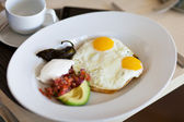 Sunny side up eggs on a plate — Stock Photo