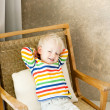 Toddler lying in the chair — Stock Photo
