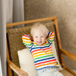 Stock Photo: Toddler lying in the chair