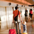 Family in airport — Stock Photo #6403210