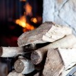 Firewood and fireplace — Stock Photo