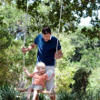 Royalty-Free Stock Photo: Father and son on a swing