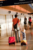 Family in the airport — Stock Photo