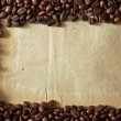 Coffee beans on paper — Stok fotoğraf