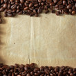 Coffee beans on paper — Stock Photo