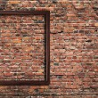 Photo frame on brick wall — Stockfoto