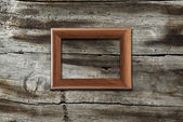 Frame on old wooden background — Stock Photo