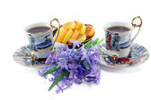 Two cups of coffee with flowers — Stock Photo