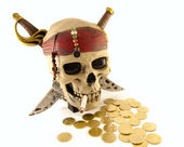 Skeleton pirate skull with metal coins and a cigarette — Stock Photo