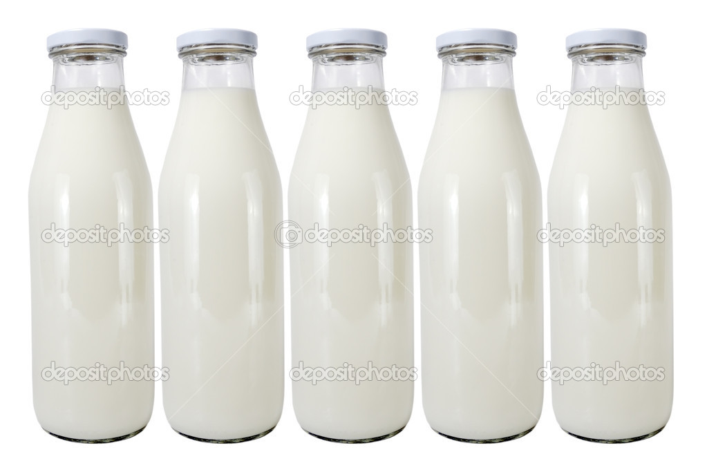 Five glass bottles with milk on a white background — Stock Photo #6391401