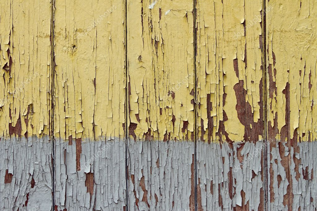 Yellow paint peeling off old wooden boards — Stock Photo #6658588