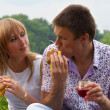 Royalty-Free Stock Photo: Young happy couple eating together outdoors