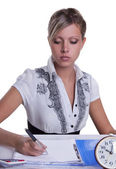 Businesswoman sitting with documents and fills — Stock Photo