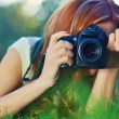 Young woman photographer — Stockfoto