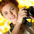 Young woman photographer — Stock Photo #5439298