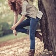 Young slim woman autumn portrait - Foto Stock