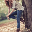 Stock Photo: Young slim woman autumn portrait