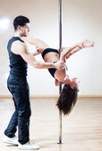 Pole dance trainer — Stock Photo