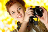 Young woman photographer — Stock Photo