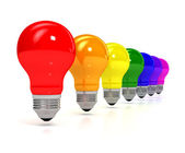 Rainbow bulb over white background — Stock Photo