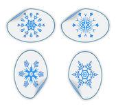 Uppsättning blå klistermärken med snöflingor. eps10 — Stockvektor