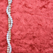 White and pink pearls on terracottvelvet — Foto Stock #5410097
